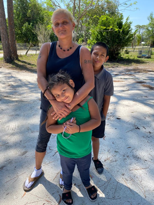 Eneida Torres, pictured with her kids Naya and Emilio, live day by day and try to stay positive. It's been awhile since she had a job, but she won't give up.