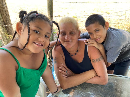 Eneida Torres is pictured with her son Emilio, 10, and daughter Naya Lee, 6.