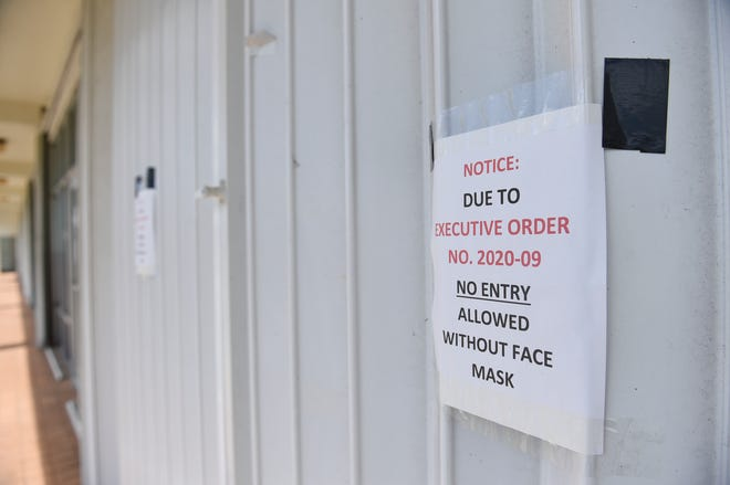 Signs posted on Barrigada businesses indicate closures due to the coronavirus outbreak on May 3, 2020.