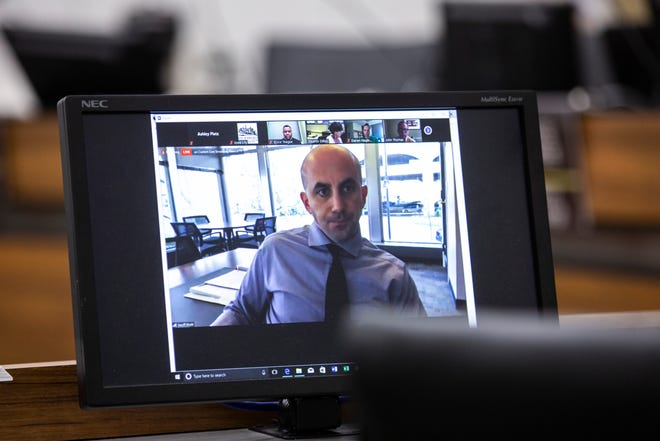 Geoff Fruin, Iowa City City Manager, is seen on a monitor while speaking during a council meeting that is being held on a video conferencing system due to the coronavirus pandemic, Tuesday, April 21, 2020, at the Emma J. Harvat Hall inside City Hall in Iowa City, Iowa.