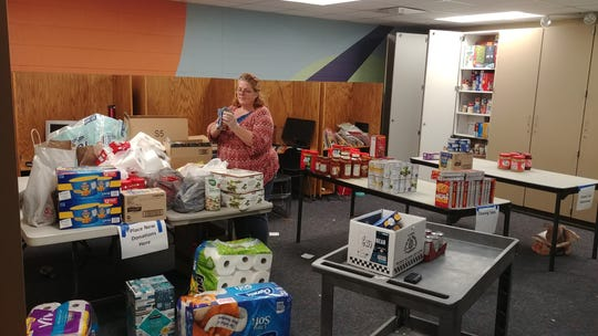 Susan Huffman cleans donations to The Cabbage Patch food pantry.