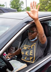 Shirley Eskridge waves her hand in prayer during the drive-in worship service in the parking lot at Pentecostal Temple Church of God in Christ in Memphis, Tenn., on Sunday, May 3, 2020.