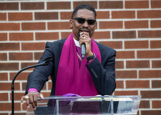 Bishop Charles H. Mason Patterson preaches during a drive-in worship service in the parking lot at Pentecostal Temple Church of God in Christ during the coronavirus outbreak in Memphis, Tenn., on Sunday, May 3, 2020.