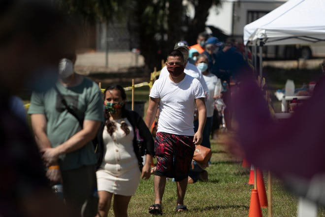 Immokalee residents line up  for COVID-19 tests conducted by Florida National Guard, with support of the Florida Department of Health in Collier County on Sunday, May 3, 2020 at the Florida Department of Health in Immokalee.