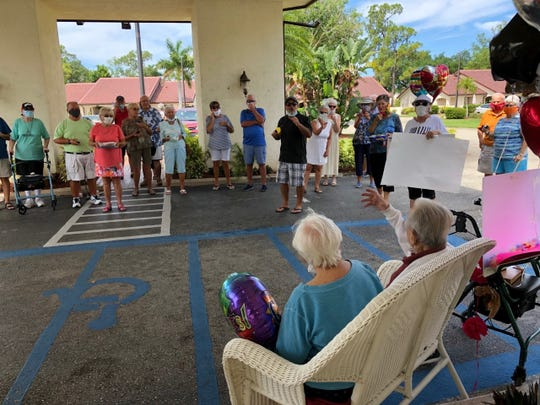 Yolanda and Joe Tenaglio, seated, greet their old friends and neighbors, who had just honored them on their 73rd anniversary with a parade in front of the Lely Palms senior residential center on Sunday, May 3, 2020.