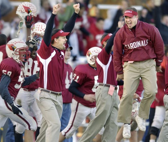 Pompton Lakes football coach Scott Mahoney (left) celebrates after defeating Glen Rock in the North 1 Group 1 semifinal at Hershfield Park, 11-19-2005