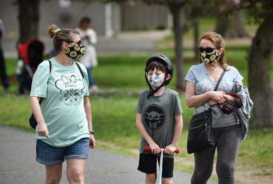 Public parks opened since being shut down, due to the Coronavirus,  visitors wearing masks enjoy being at Saddle River County Park  in Saddle Brook on 05/03/20.