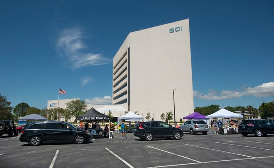 """Palafox Market  teaming up with Studer Properties held a special """"Drive-N-Shop"""" Palafox Market  Sunday, May 3 2020 at the  SCI Bldg. on W Garden Street. Each vendor had a list of produce/goods available for purchase."""