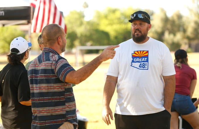 Great 48! co-founder Jeremy Wood, right, talks with people during the Freedom of Speech - Re-Open the Great 48 barbecue at Sereno Park in Scottsdale on Saturday, May 2, 2020.