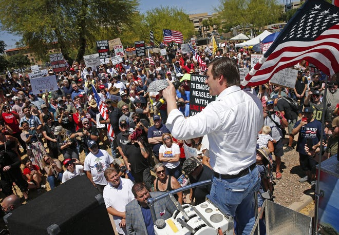 Arizona Republican Senate candidate Daniel McCarthy speaks to the crowd during a rally for the governor to open the state at Wesley Bolin Plaza in Phoenix on May 3, 2020.