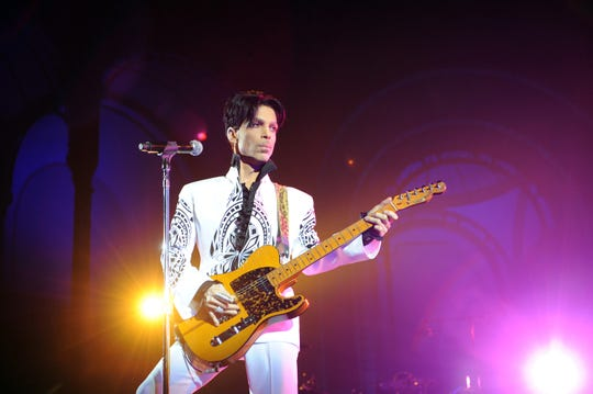 In this file photo, US singer Prince performs on October 11, 2009 at the Grand Palais in Paris. Prince is among the Rock & Roll Hall of Fame inductees whose performances are preserved in the video vaults of the Rock & Roll Hall of Fame website and YouTube channel. The 2020 induction ceremony was supposed to air live on HBO on Saturday. It has been rescheduled to Nov. 7.  (Bertrand Guay/AFP via Getty Images)