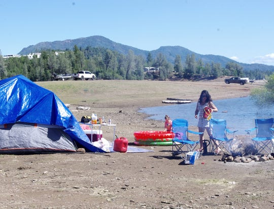 Jasmine Groober of Redding, Calif.,  prepares to go  home Sunday after a weekend camping at Lake Shasta. Texas campers can soon return to state parks after the Texas Parks and Wildlife Department announced they would be allowing overnight camping again beginning May 18.