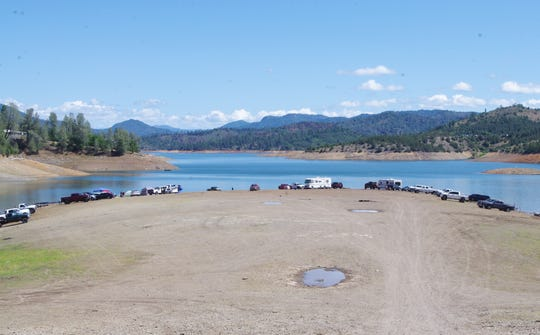 After the U.S. Forest Service closed developed campgrounds around Lake Shasta, campers lined the shores of the lake in the Jones Valley area on Sunday.
