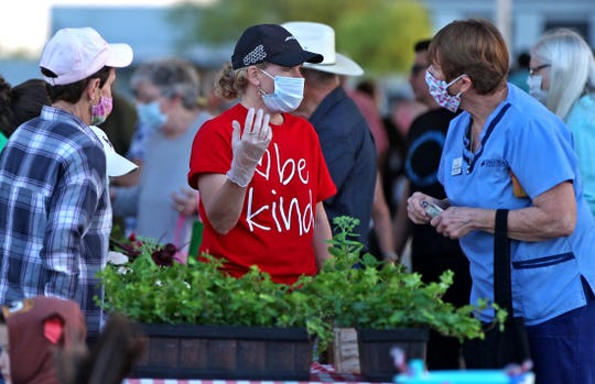 Customers and vendors gather at the Concho Valley Farmer's Market in San Angelo on Saturday, May 2, 2020 with new guidelines to prevent the spread of the coronavirus.