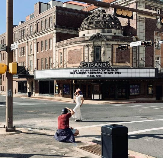 A photo session in front of the Strand Theater.