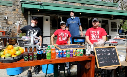 The Dog Den, a hot dog and snack shop at 1 Main St. in White Plains, was open for food and drinks at the opening of the 46th annual Bicycle Sundays on May 3, 2020. Pictured are Robert Garcia, Faby Conde, owner Dennis Rubich and Carlos Barrezueta.