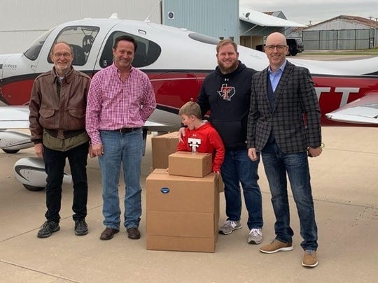 Angel Flight pilots flew donated face shields and intubation chambers into Kickapoo Downtown Airport on April 17 for distribution to local hospitals. Wichita County district attorney's Chief Investigator Tye Davis, far right, volunteered to deliver the items to local hospitals.