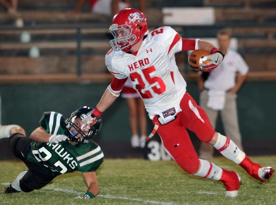 Holliday Eagles running back Sam Shirley (25) cuts upfield after avoiding a tackle in a 2011 football game. Shirley passed away at the age of 25 Friday, May 1, 2020.