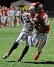 Patrick Johnston/Times Record News Holliday's Sam Shirley (25) battles past Hirschi's Markel King (3) in a 2011 football game. Shirley passed away Friday, May 1, 2020.