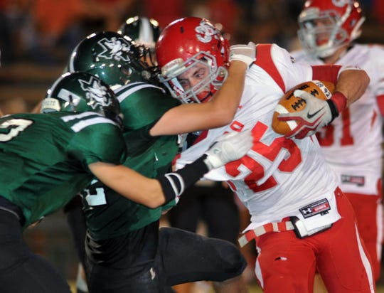Holliday running back Sam Shirley (23) battles for yards in a 2011 football game against Iowa Park. Shirley passed away at the age of 25 Friday, May 1, 2020.
