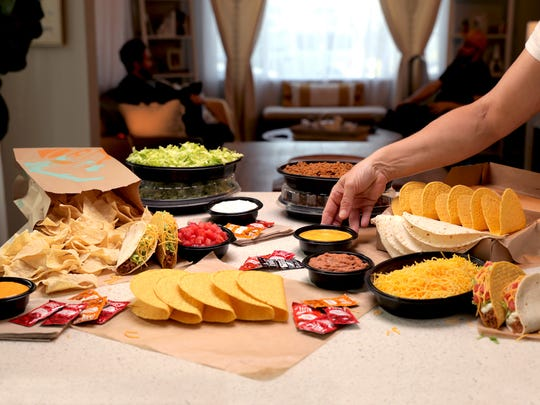 Taco Bell's At Home Taco Bar ($25) feeds a party of six and comes with flour tortillas, crunchy taco shells, nacho chips, seasoned beef, shredded lettuce, nacho cheese sauce, hot sauce packets and more.