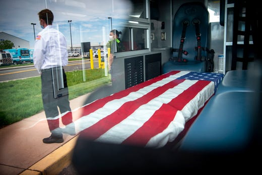The casket of  Paul Cary rests in the back of an Ambulnz ambulance at Newark International Airport where his body will be flown back to his home state of Colorado on May 3, 2020. Cary died of complications from COVID-19, he became sick while serving as a volunteer with Ambulnzís State of New York COVID Response team.