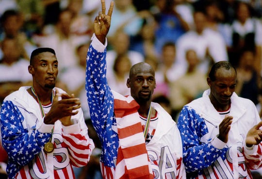 Scottie Pippen, Michael Jordan and Clyde Drexler during the 1992 Olympic gold medal ceremony.
