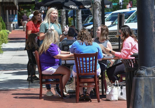 Server Lilly Franklin of Raines on Main gets order from a group of Homeland Park Elementary school teachers in downtown Anderson, S.C. Monday, May 4, 2020. State Gov. Henry McMaster announced May 1 that restaurants could reopen outdoor dining spaces May 4, as long as they follow standards on cleaning and social distancing. Since March 18, restaurants have been restricted to curbside or delivery services in response to concern for public health during the coronavirus pandemic.