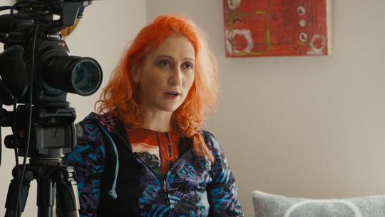 "Director Rachel Mason in the 2020 Netflix documentary ""Circus of Books."""