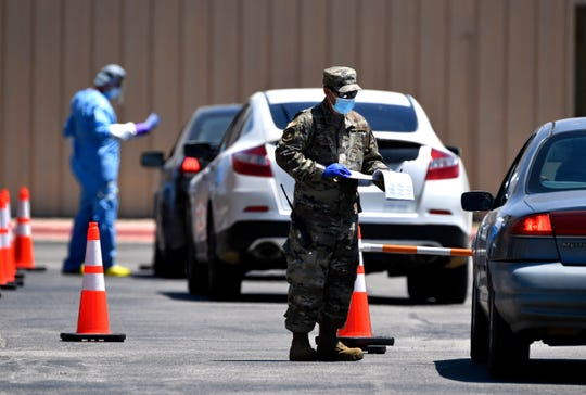 Cars line up at Wylie Baptist Church for COVID-19 testing conducted by Texas National Guard troops May 2.