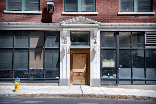 The door of The Imperial Life and Table, dirty from recent College Street construction, is nailed shut downtown on May 1, 2020. The bar and restaurant, both owned by Jacob Sessoms, are closed and will be revamped before opening up again. Table will be moving to a different downtown location.
