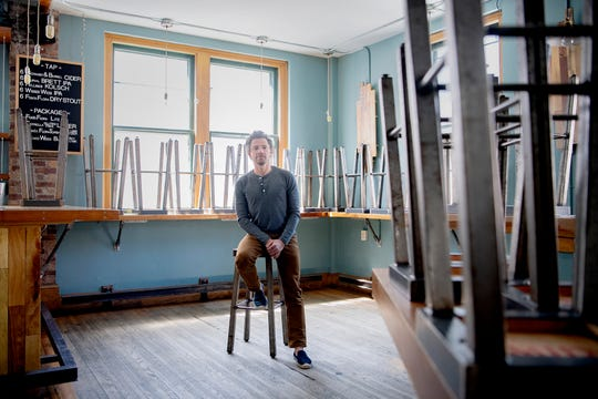 Jacob Sessoms, soon-to-be owner of four downtown concepts, is photographed in his empty cocktail bar, The Imperial Life, on College Street in downtown Asheville on May 1, 2020. The bar, which closed due to COVID-19, will be redone when it reopens and his restaurant in the space below, Table, will be revamped and moved to a different downtown location.