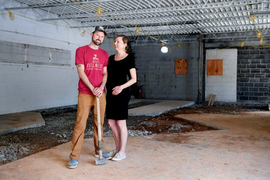 Mark and Kerry Goodwin stand inside the future Cellarest Beer Project May 1, 2020 in West Asheville.