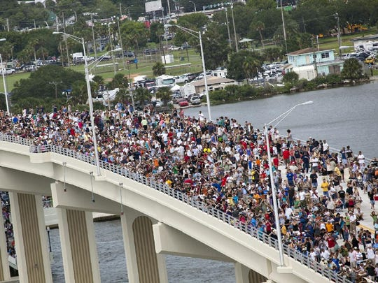 Crowds gather on Max Brewer Bridge in Titusville to see the 33rd flight of Atlantis, the 37th shuttle mission to the space station, and the 135th and final mission of NASA's Space Shuttle Program.