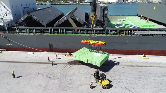 These are among 1,000 bales of wood pulp weighing 2 metric tons apiece that were unloaded at Port Canaveral from the cargo ship Flora Schulte.