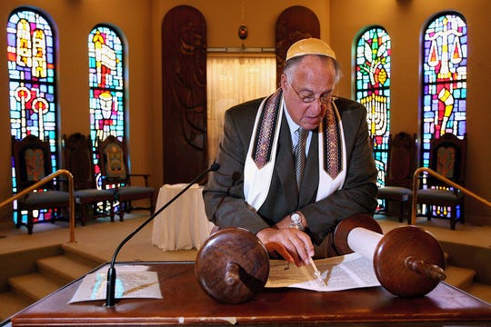 Rabbi Kenneth Roseman looks over part of the torah that he will be reading during the welcoming Sabbath service Friday, May 4, 2007.