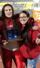 Paulsboro's Tino Savaiinaea (left) poses with his sister Katie and the sectional hardware from 2017 South Jersey Group 1 championship game.