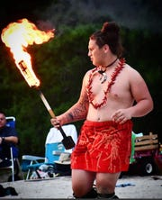 Paulsboro's Tino Savaiinaea participates in a traditional fire knife dance with his family's Polynesian dance group. The rising senior is a two-way lineman for the Red Raiders.