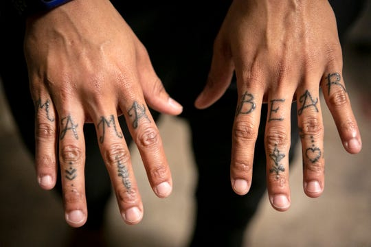 Jas Hubbard has the words 'Mama Bear' tattooed on her hands. She wears the honor proudly. Hubbard had her son, Jayden, now 14, when she was a student at Campbell County High School. Jayden, who has autism, calls her Mama Bear for her willingness to always come to his defense.