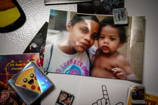 A photo of Jas Hubbard and her son, Jayden, hangs on the refrigerator inside of their Cincinnati home. Hubbard had her son when she was a student in high school and graduated from Campbell County in 2009, working three or four nights a week at Burger King and a telemarketing company after school.