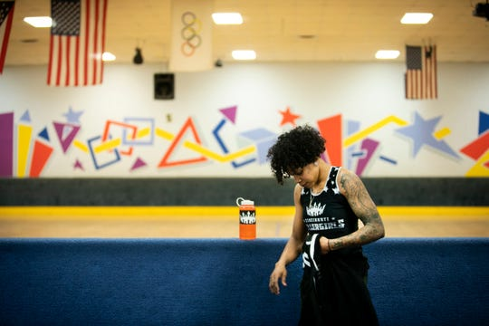 Jas Hubbard prepares for practice for the Cincinnati Rollergirls, on February 27 at Skatetown USA, in West Chester. The Cincinnati Rollergirls is Cincinnati's first women's amateur flat track roller derby team that began in 2005, Hubbard has been on the team since 2015.