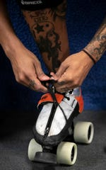 Jas Hubbard laces up her skates for practice for the Cincinnati Rollergirls, on February 27 at Skatetown USA, in West Chester. The Cincinnati Rollergirls is Cincinnati's first women's amateur flat track roller derby team that began in 2005, Hubbard has been on the team since 2015.