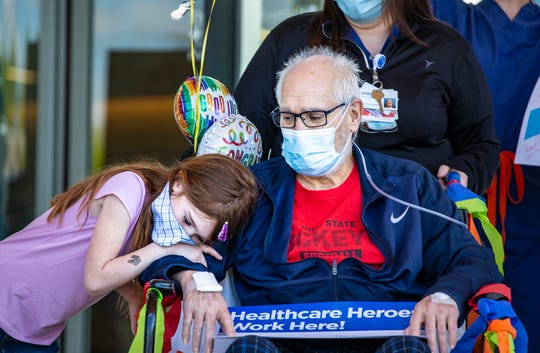 Maddy Kaehler, 7, hugs her grandfather Daniel Pilder, 70, of Finneytown after he was released from Jewish Hospital Friday, May 1, 2020, after battling the coronavirus for 45 days. He was the first COVID patient at the Jewish Hospital - Mercy Health. Pilder was on a ventilator for 28 days.