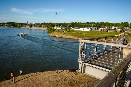 Residents hang out at Freedom Point fishing, getting air, or speeding away on a boat after safer at home orders were lifted at Liberty Park in Clarksville, Tenn., on Friday, May 1, 2020.