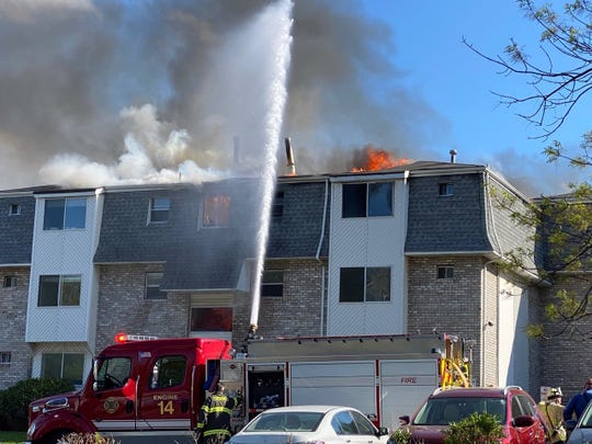 Firefighters work to extinguish the fire at an apartment buildings along Parsonage Road in Edison.