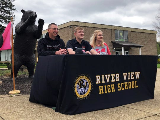 River View senior baseball player Jaxon Rinkes sits with his parents after announcing his commitment to Muskingum on Friday at the high school. He was one of four Black Bears to announce their college intentions.
