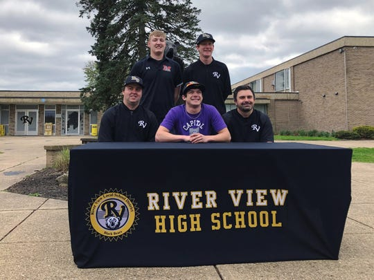 River View senior baseball player Justin Mason, middle, poses with teammate Jaxon Rinkes, top left, and his coaches after making his college choice on Friday at the high school. Rinkes, who will play at Muskingum, was one of four senior athletes to make their college choices.