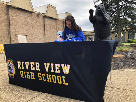 River View senior soccer player Emmie Brenly signs her letter of intent with Ohio Christian on Friday at the high school. Brenly, one of four Black Bears to announce their college plans, was a first-team All-Ohioan.