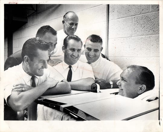 It was hot Wednesday in July 1962, but not hot enough for large Lester Bingaman, assistant Detroit Lions  coach. He dunked himself in a sweat cabinet as the Lion staff assembled to start working on plays for the first game here on August 11 with the Cleveland Browns. Grinning at Bing are (from left): Bob Nussbaumer, head coach George Wilson, Don Shula and Aldo Forte. That's Scooter McLean in the back.