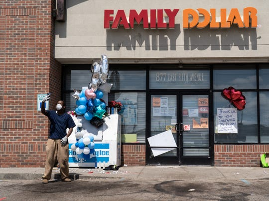 Bennie Hicks of Flint takes a photo in front of the Family Dollar in Flint on Monday May 4, 2020, where his cousin, Calvin James Munerlyn, worked as a security guard. Munerlyn was shot and killed after an argument over a customer needing to wear a face mask while shopping in the store on Friday, May 1, 2020.